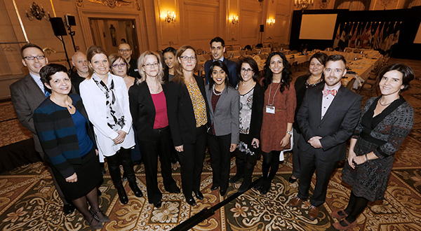 CICS employees and other logistics staff with conference delegates at the Meeting of the Canadian Council of Tourism Ministers (Photo: John Woods, Canadian Press Images)