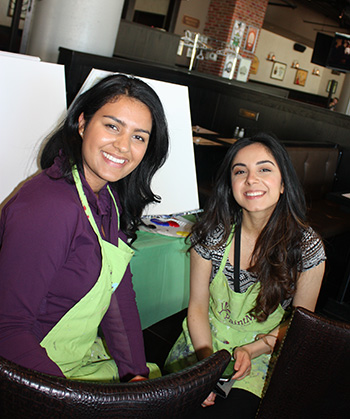 Summer students, Pareesa Bina and Yasna Sarwar at a CICS painting group activity