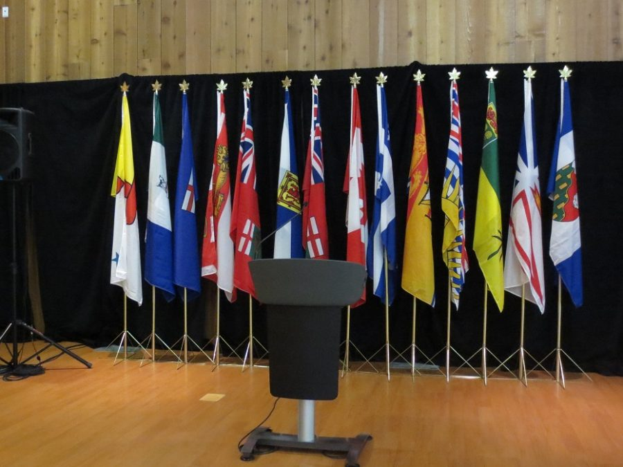 Photo of a podium in front of flags