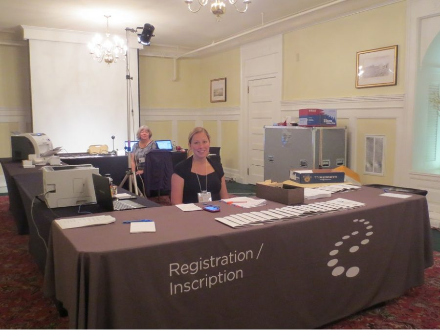 Photo of a CICS employee at the registration desk